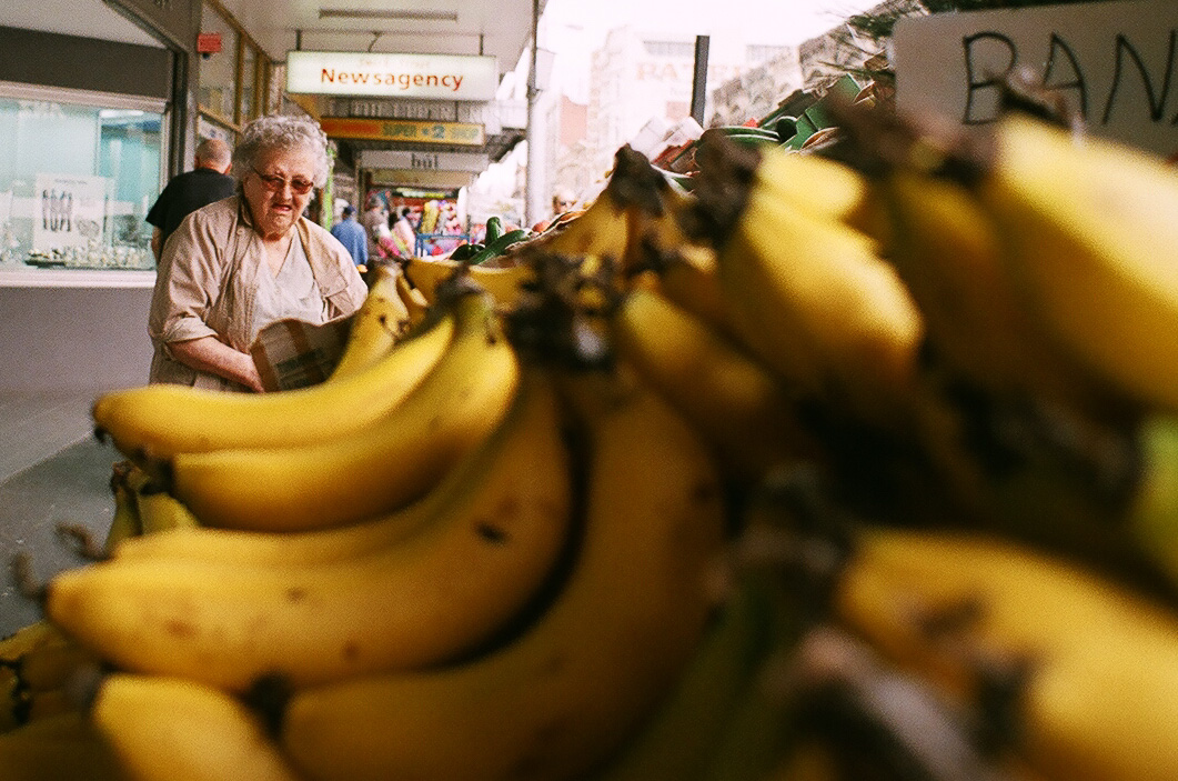 Film photo of old lady with bananas