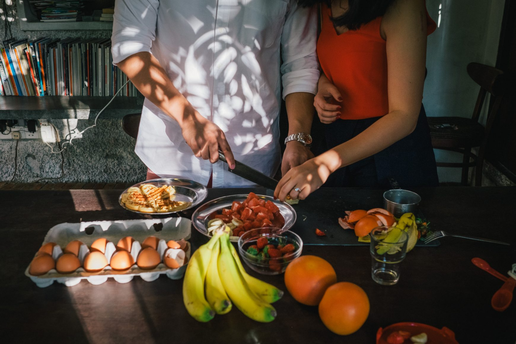 Engaged couple cooking together in a prewedding shoot