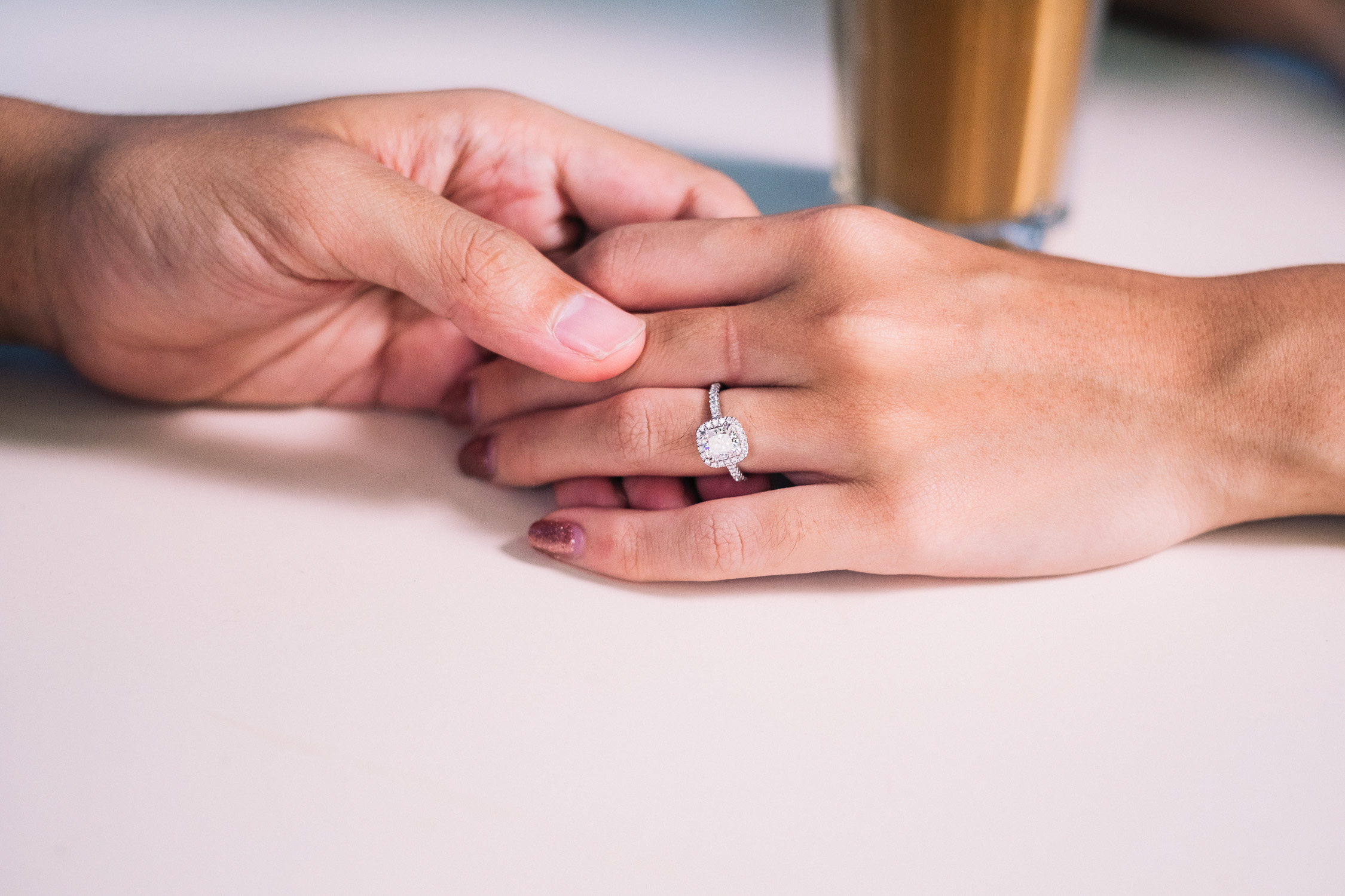 A close up of Suwan's diamond engagement ring from their Singapore prewedding shoot