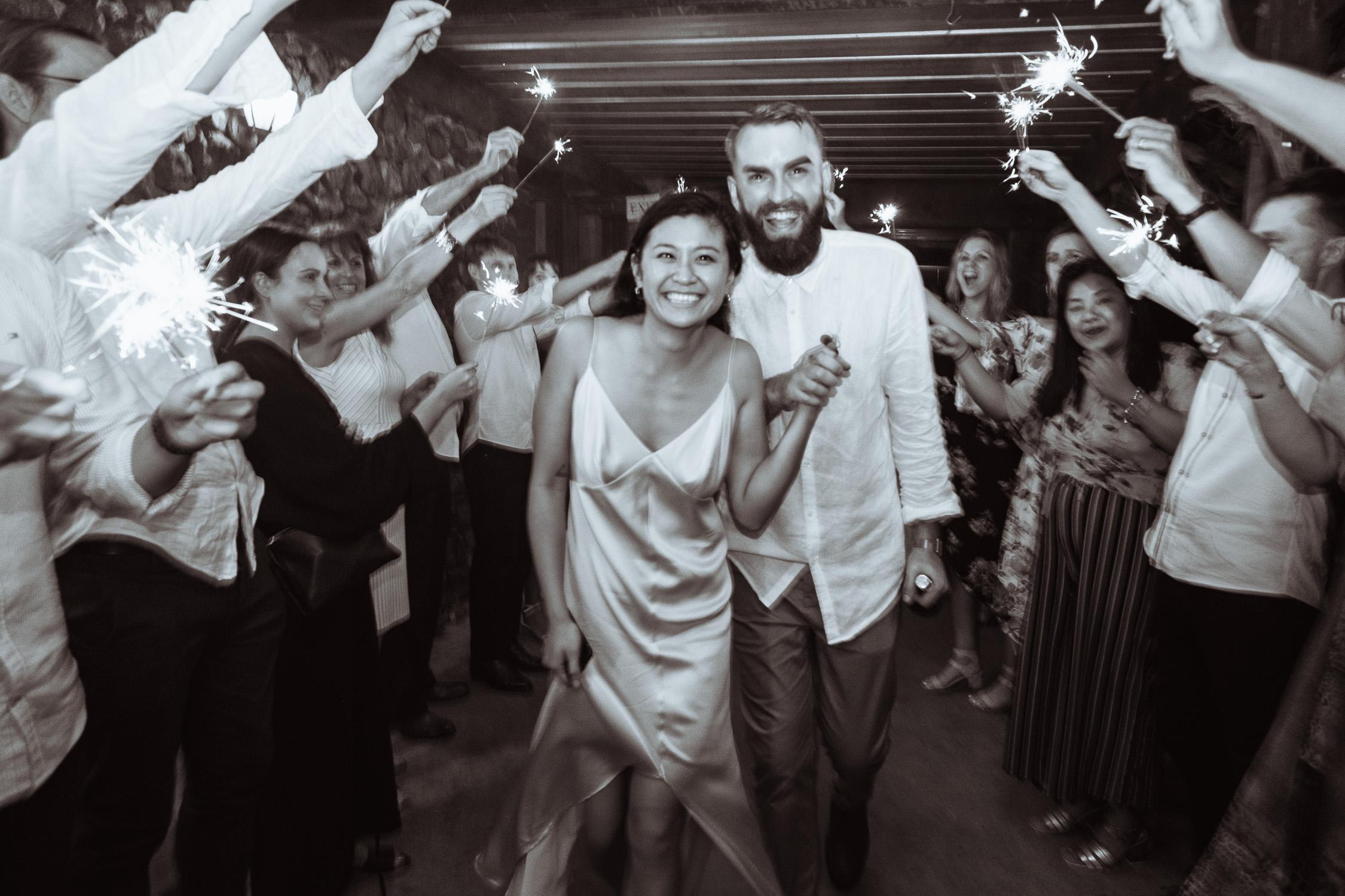 Melbourne Sunnystones Camp Wedding - bride and groom sparkler exit