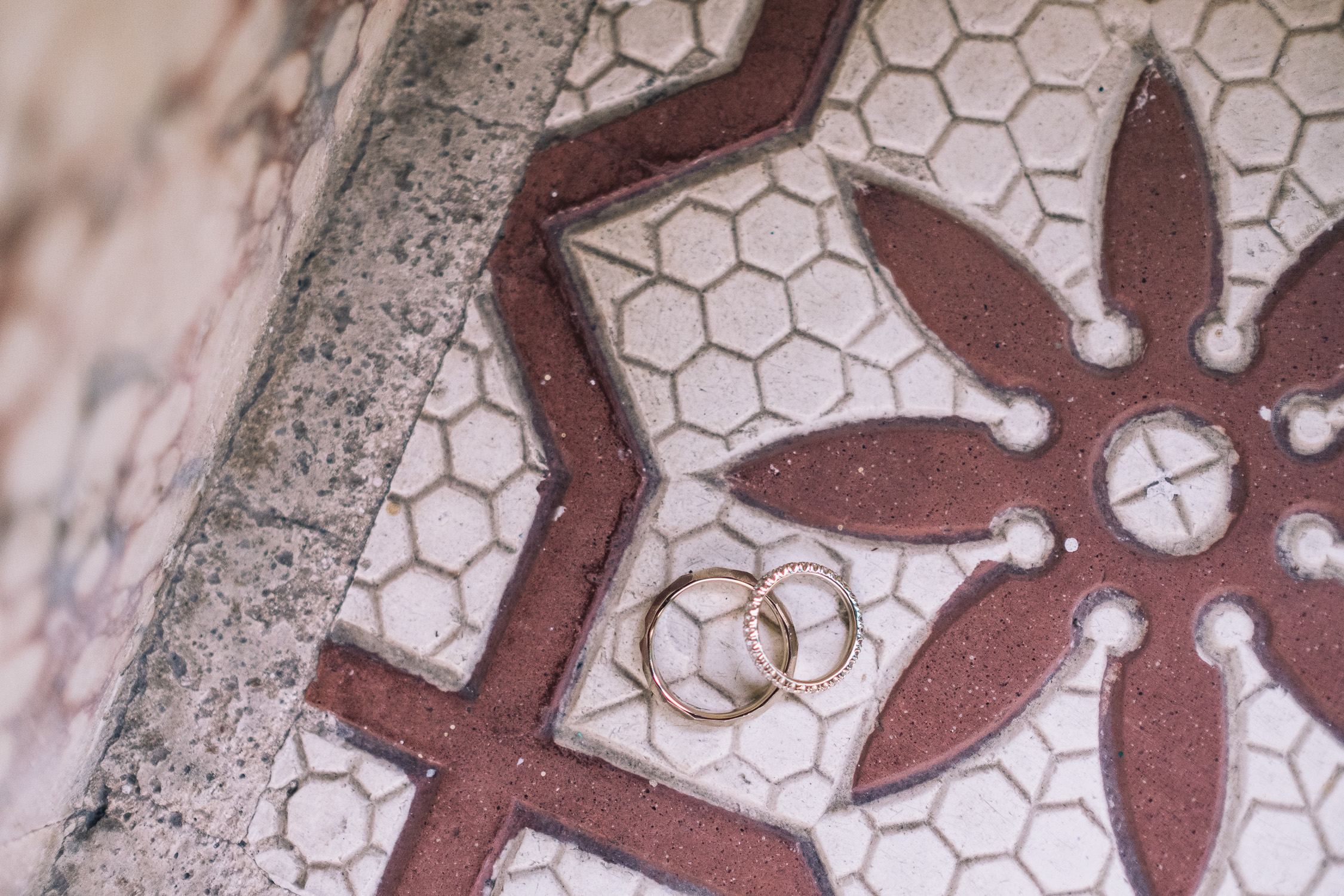 Wedding rings on traditional tiled floor in Singapore prewedding shoot