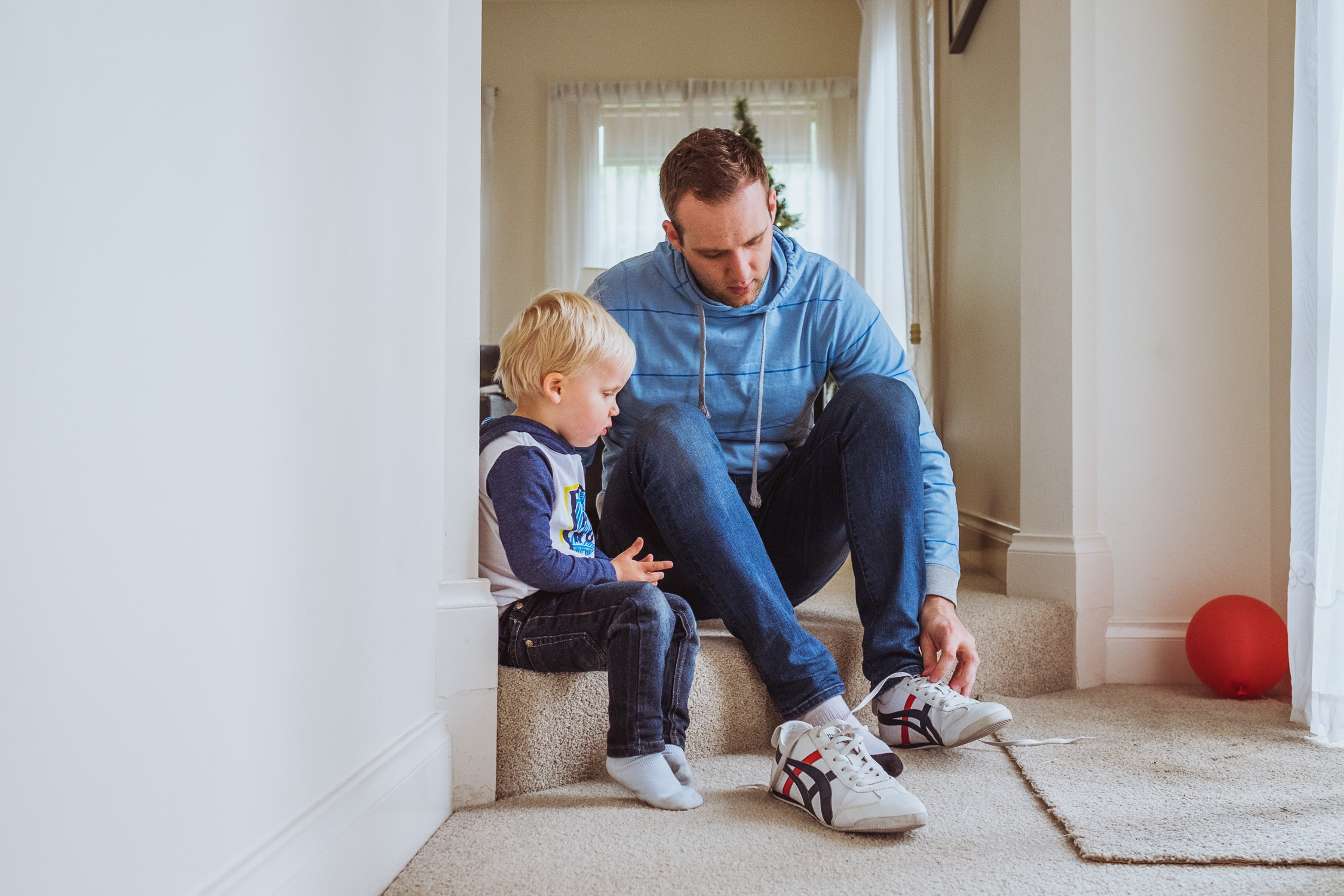 Day In The Life - dad teaching toddler to tie shoes